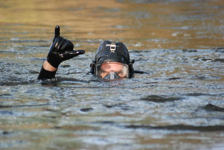 dive rescue international diver showing shaka
